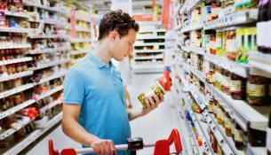 People in supermarket choosing food